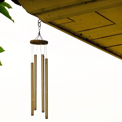 a beautiful 4-rod wind chime hanging from the balcony roof