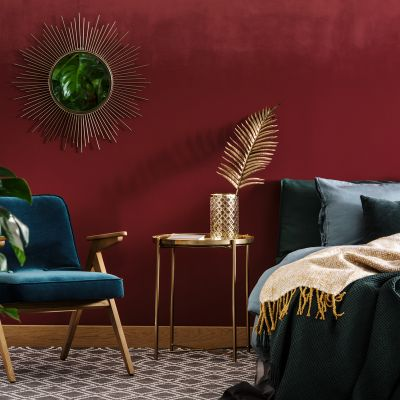 A sophisticated look achieved with deep red interior with decorative mirror