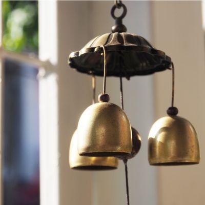 Beautiful brass wind chime hung near a window